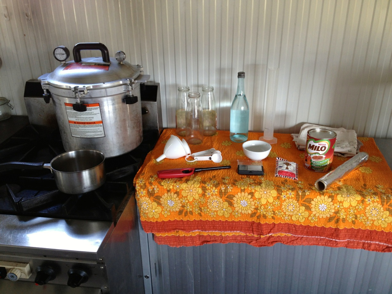 The Milkwood DIY agar sterilisation unit. Orange tablecloth optional.